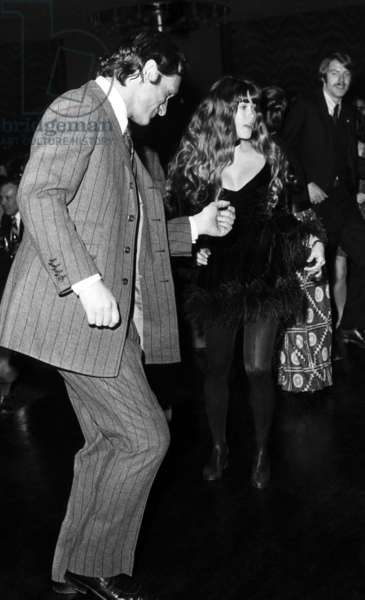 Hugh Hefner and Barbi Benton dance at a party at the Playboy Club-Hotel in McAfee, New Jersey. ca 1972.
