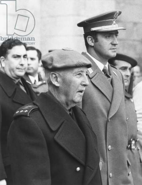 Spain's dictator, General Francisco Franco and his designated successor, Prince Juan Carlos. Dec. 1, 1972. They were at a memorial service honoring José Antonio Primo de Rivera, founder of the Falange, Spain's revolutionary Fascist Movement of the 1930s. Once in power after Franco's death, Juan Carlos was a progressive constitutional monarch