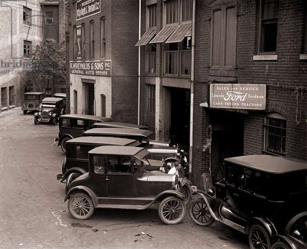 Model Ts, and one more luxurious Lincoln (center front) are parked by a Ford Motor Company dealership in Washington, D.C. in 1926