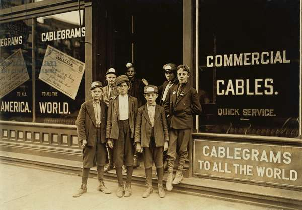 Teenage and child Telegraph messengers, completed the final leg of long distance communication by delivering the physical paper telegraphs. This group of child laborers was photographed by Lewis Hine in Indianapolis, 1908