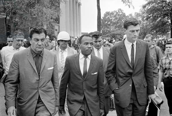 Integration at Ole Mississippi University, James Meredith (center), walking to class accompanied by U.S. marshals, by Marion S. Trikosko, October 1, 1962