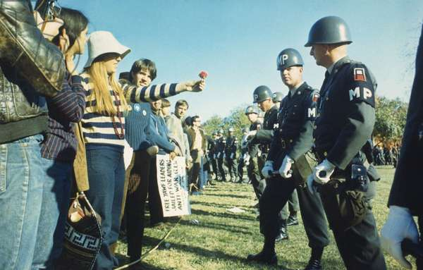 Female demonstrator offers a flower to military police during the 1967 March on the Pentagon. 50,000 Anti-Vietnam War demonstrators were led by Abbie Hoffman and marched from the Lincoln Memorial to The Pentagon on Oct. 21, 1967