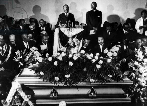 Martin Luther King Jr. (center, standing), giving a eulogy for Jimmie Lee Jackson at a funeral service in Marion, Alabama, March 3, 1965.