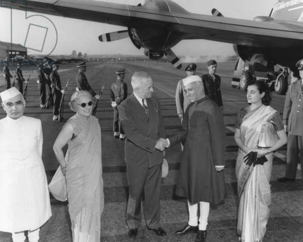 President Harry Truman welcomes the Prime Minister of India, Jawaharlal Nehru, at Washington Airport. With the Prime Minister's are his sister, Madame Pandit and daughter, Indira Gandhi.