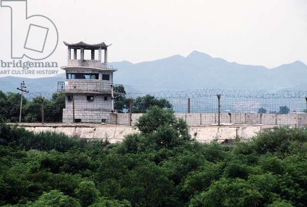North Korean guard tower decorated with a Communist red star on the wall and barbed wire separating South Korea from North Korea. The Military Line of Demarcation runs just in front of the wall. Sept. 18 1993