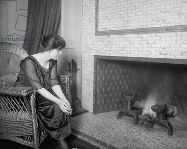 Anita Pollitzer in front of fireplace, c. 1920. Pollitzer was a women suffrage activist and held leadership positions in the National Woman's Party