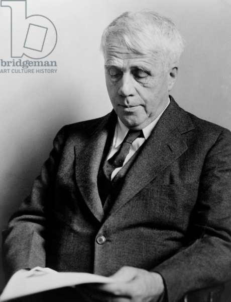Robert Frost (1874-1963), American poet reading in 1941