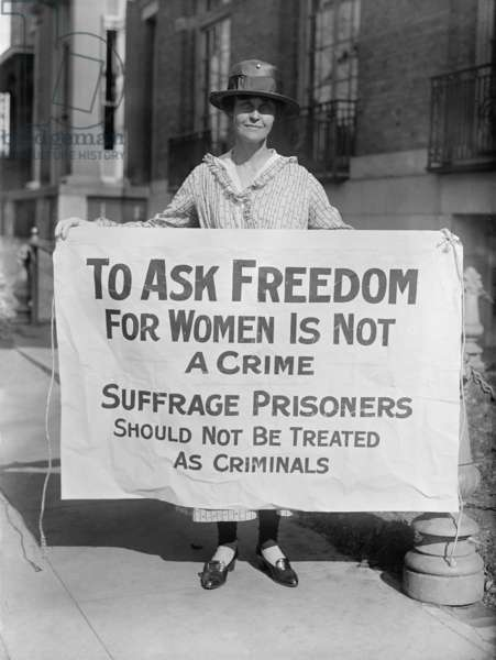 Woman suffrage picket protests criminal arrests of militant protestors from the National Woman's Party (NWP). As prisoners, Alice Paul and others demanded to be held as political prisoners, and staged hunger strikes