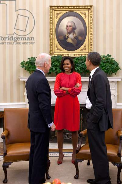 President Obama and VP Joe Biden talk with First Lady Michelle Obama in the Oval Office. Nov. 21, 2011