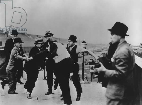 Battle of the Overpass at Ford River Rouge plant. Ford thugs vs. UAW. May 1937. Ford's thugs beat Richard Frankenstein after pulling his jacket over his head. Photo by James Kilpatrick of the Detroit News
