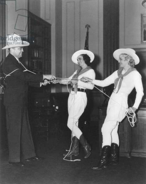 FBI Director J. Edgar Hoover is lassoed by Texas Rangerettes at the Texas Expo. c. 1935-1940