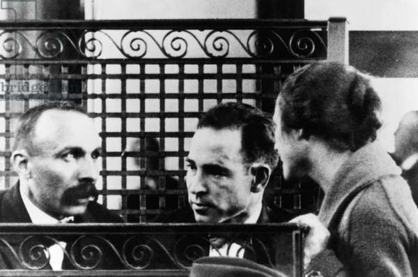Rosina Sacco (far right), visiting her husband Nicola Sacco (center), and Bartolomeo Vanzetti (far left), in Norfolk County Courthouse, Massachusetts, 1923. Sacco and Vanzetti were accused of murder and robbery, and electrocuted in 1927.