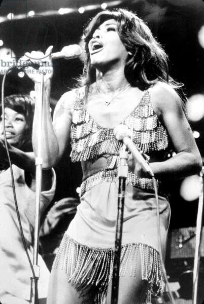 TINA TURNER, during a performance, c.1971.