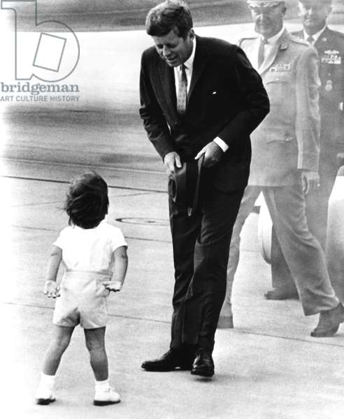 President John F. Kennedy, being greeted by his son, John F. Kennedy, Jr., c. 1963