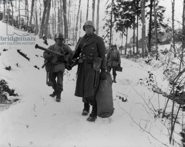 Three soldiers of the U.S. 101st Engineers, held their woodland position all night. They defended it against German counter attack, near Wiltz, Luxembourg. Jan. 14, 1945, Battle of the Bulge, World War 2