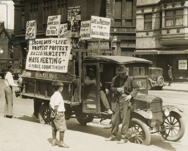 Truck with several protest signs five days prior to the executions of Sacco and Vanzetti. Signs read, '5 MORE DAYS TO LIVE, PROTEST PROTEST, SACCO & VANZETTI, MASS MEETING, At the public Square Tonight; Life & Freedom for Sacco & Vanzetti. August 1927.