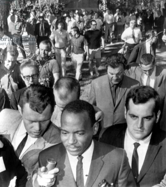 James Meredith, first African American ever enrolled at the University of Mississippi is trailed by reporters and U.S. Marshals on his second day of classes, Oxford, MS, October 02, 1962.