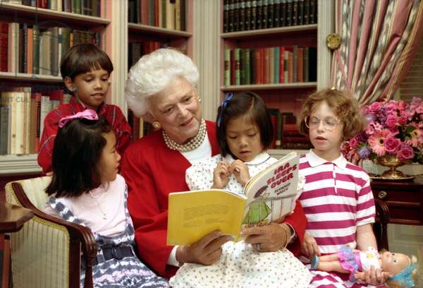 First Lady Barbara Bush reads to children in the White House Library. As First Lady, she supported literacy programs and encouraged family reading. July 24, 1990