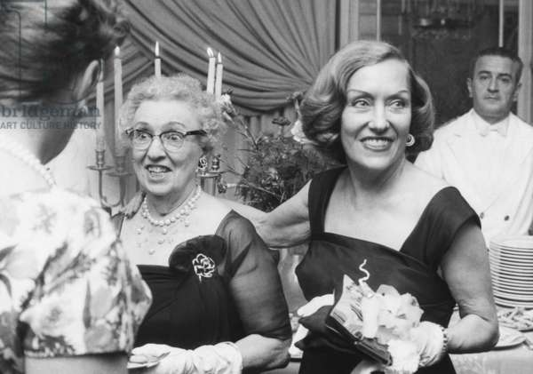 Actress Gloria Swanson (right) and her mother, Mrs. Charles Woodruff, holidaying in Rome. Sept. 27, 1961. Swanson tossed the party in honor of her mother at a Via Veneto Hotel