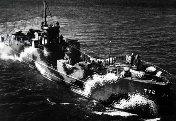 Starboard bow view of U.S. ship LCI 772, with camouflage painting. The patterns reduced the ship's visibility and confuse identity. July 30, 1944, World War 2