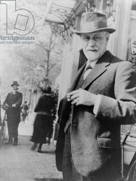 Sigmund Freud (1856-1939), standing on sidewalk outside The Hague, Netherlands, 1920