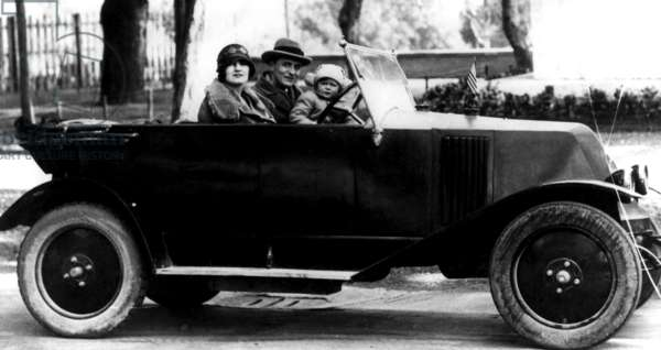 F. Scott Fitzgerald, his wife Zelda and his daughter, Scottie, go out for a drive somewhere in Italy. c. 1924-1931.