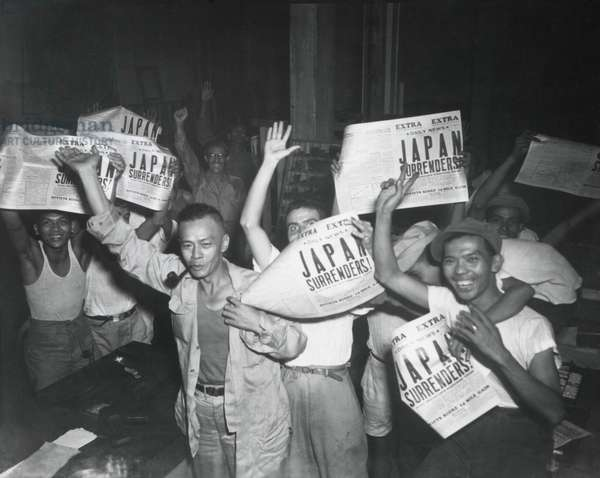 Filipinos celebrate headlines, 'Japan Surrenders' at the end of World War 2. August 10-15, 1945