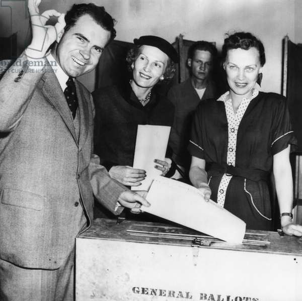 1962 Presidential Election. Senator Richard Nixon, Republican candidate for Vice President (and future US President), and wife Patricia Nixon (future First Lady) cast their ballots. From Left: Richard Nixon, Patricia Nixon, Margaret Richardson, chief election clerk. Whittier, California, November 4, 1952