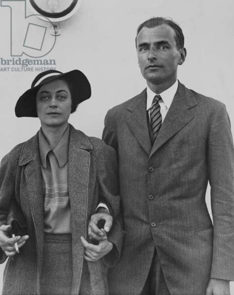 Herbert S. Agar arriving in New York on the S.S. Olympic, with his wife, June 5, 1934. Ager won the 1934 Pulitzer Prize for Biography for THE PEOPLE'S CHOICE, a study of the six early U.S. Presidents. His wife, Eleanor Carroll Chilton was the author of two novels, SHADOWS WAITING, 1926, and BURNING FOUNTAIN, 1929