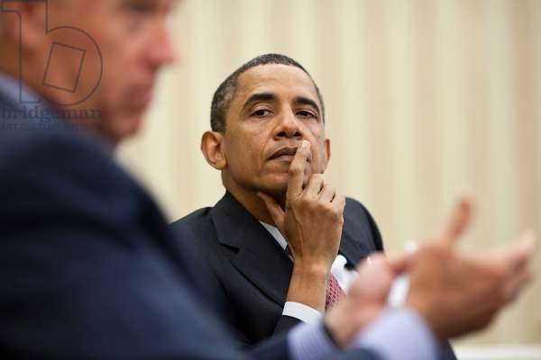 Barack Obama: President Barack Obama listens as Vice President Joe Biden makes a point during a meeting with the Democratic leadership in the Oval Office, June 23, 2011.