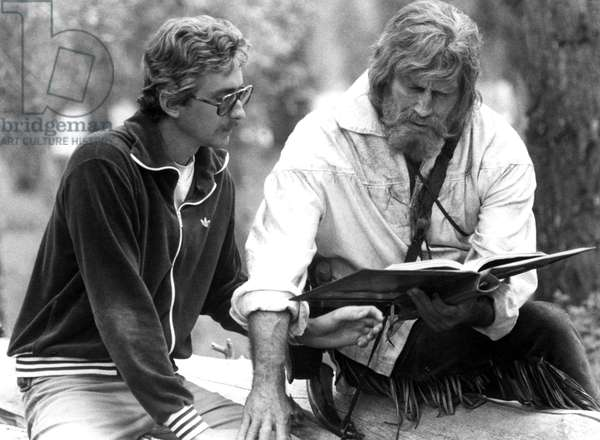 Writer-director FRASER HESTON goes over script with father CHARLTON HESTON during THE MOUNTAIN MEN, 1980