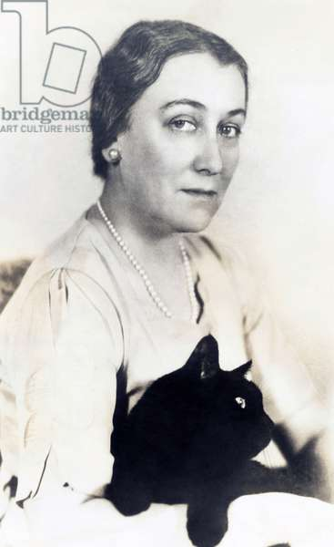 Sophie Kerr, famous writer with her pet alley cat 'Thomas Hardy'. c. 1936. Her novels and short stories dealt with class and gender issues at the work place in the first half of the 20th century
