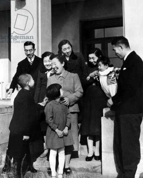 Crown Prince Akihito, Princess Suga, Prince Yoshi, Emperor Hirohito, Princess Yori, Empress Nagako, Princess Takako, Princess Shigeko, Nobuhiko, Prince Higashikuni, ca 1946.