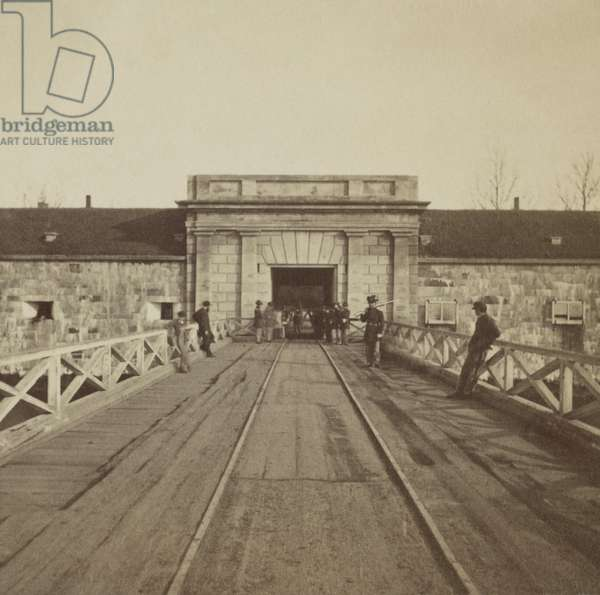 Bridge and portal to Fortress Monroe, guarded by the Union soldiers during the Civil War, 1864. The fort was commanded by General Benjamin Butler, who declared African American slaves were 'contraband of war' and would not be returned to the Confederacy. The federal government adopted this policy, and the army became a refuge from slavery for 400,000 to 500,000 African Americans. Photo by Alexander Gardner
