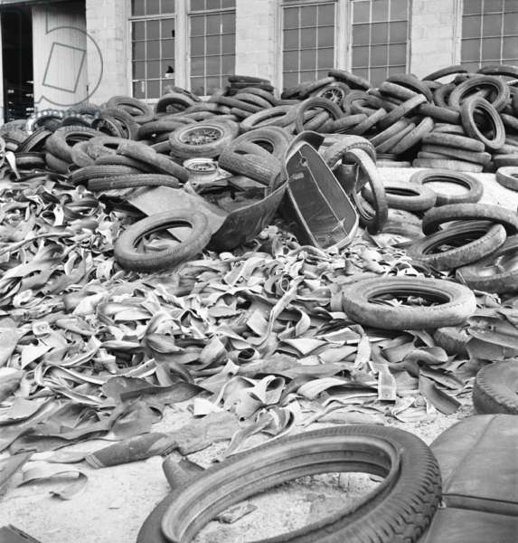 Rubber tires gathered to be recycled in August, 1941. World War II reduced rubber imports and increased demand, causing rubber to be rationed throughout the war