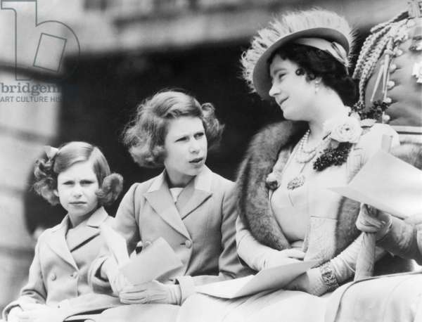 Queen Elizabeth (right), the former Duchess of York, and her children, Princess (and future Queen) Elizabeth II (center), and Princess Margaret Rose (left), c.1938