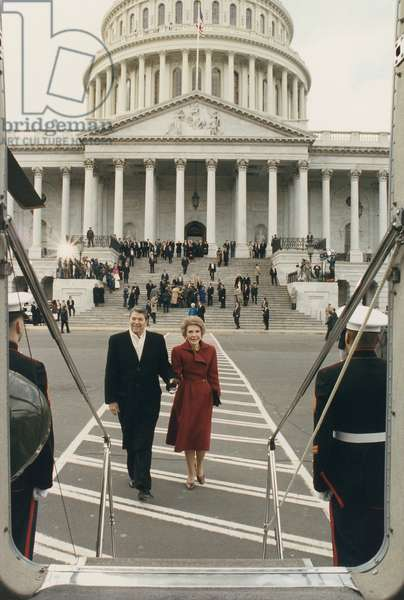 President and Nancy Reagan boarding the Helicopter to leave the U.S. Capitol on the last day of the administration. In the background are President and Barbara Bush and the U.S. Capitol. January 20 1989. PO-USP-Reagan-1989_NA-12-0144M