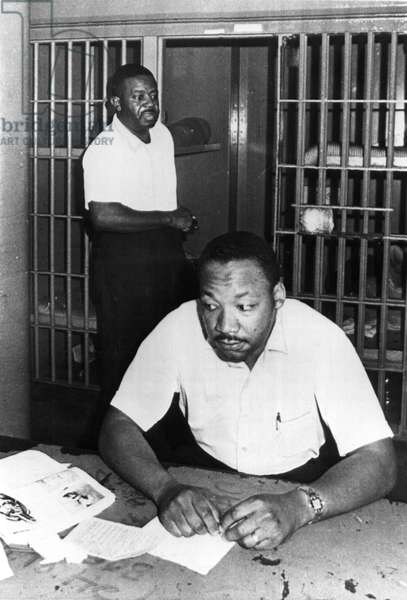 MARTIN LUTHER KING, JR, with Reverend Ralph Abernathy, in St.John's County Jail, Florida, 6/12/62.
