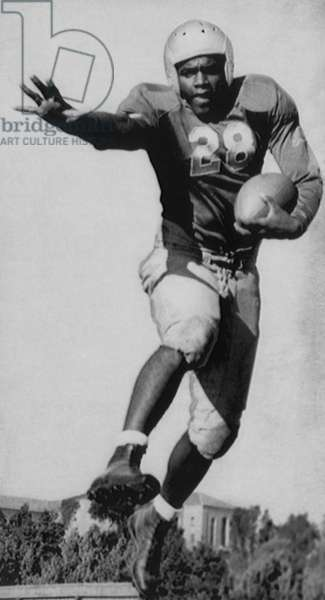 Future Brooklyn Dodger Jackie Robinson as a All Conference tailback for UCLA, 1940
