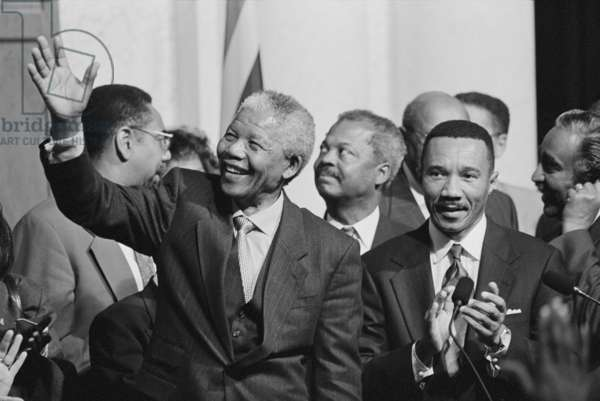 President of South Africa, Nelson Mandela with members of the Congressional Black Caucus. Oct. 4, 1994. Standing beside Mandela is Rep. Kweisi Mfume (born Frizzell Gerald Gray), Maryland Congressman