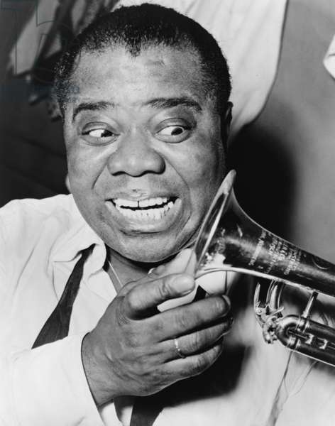 Louis Armstrong (1901-1971), African American Jazz musician, with his trademark smile and trumpet, 1953