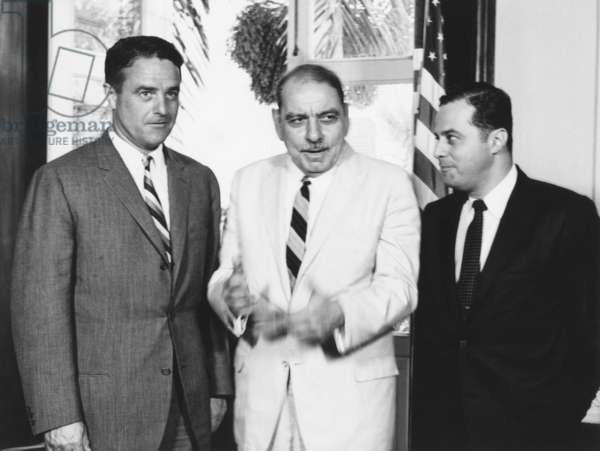 Gov. Luis Munoz Marin of Puerto Rico (center) discusses the Peace Corps with Sargent Shriver. July 11, 1961. At left is Rafael Sancho Bonet, Peace Corps representative in Puerto Rico