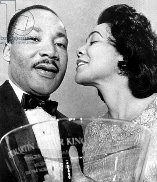 Dr. Martin Luther King Jr., being congratulated by wife Coretta Scott King, after being presented with a Steuben-Glass Bowl Award, Atlanta, GA, January 27, 1965