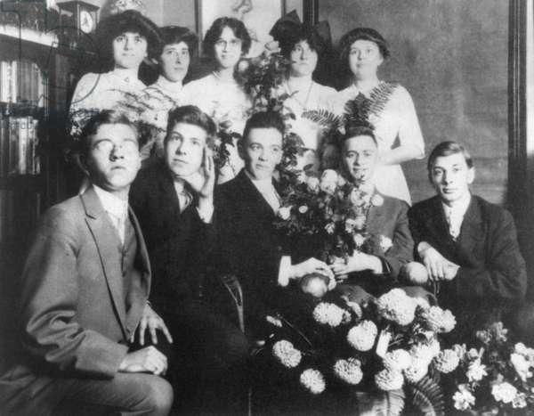 Young J. Edgar Hoover with a group of teenagers, c. 1912. The flowers and nice clothes suggest an important occasion, perhaps high school graduation from Central High, in Washington, D.C