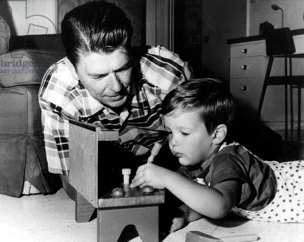 RONALD REAGAN, with son Ronald Prescott, c. 1960