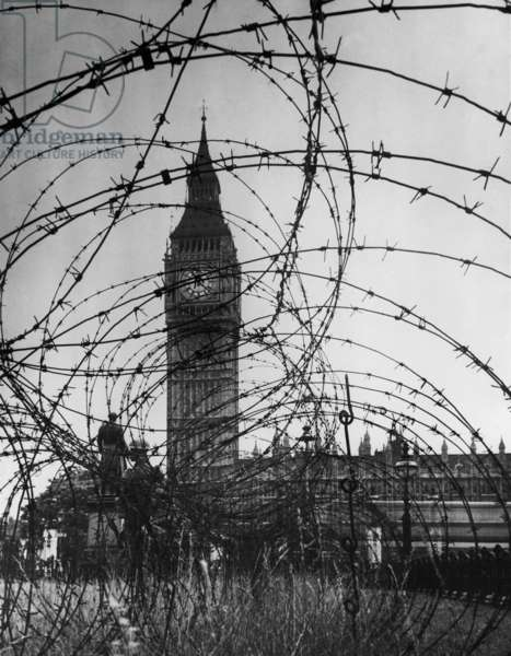 London's Big Ben with barbed wire entanglement and soldiers on guard during World War 2. c. 1940-41