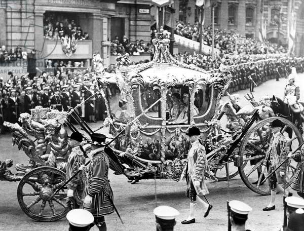 The magnificent state coach, King George VI and Queen Elizabeth I seated inside, passing through Trafalgar Square to Westminster Abbey, during the coronation procession. 5/18/37.