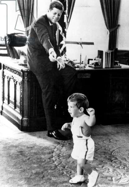 John F. Kennedy and son John F. Kennedy Jr., in Oval Office, 5/25/62