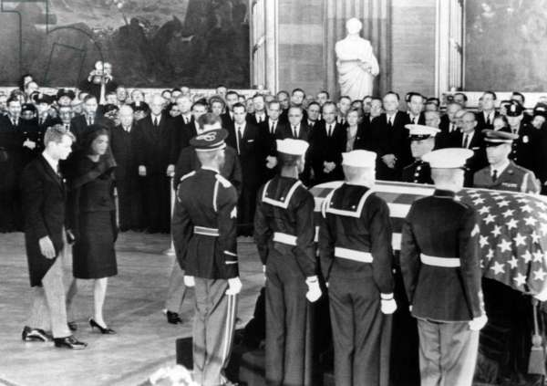 Attorney General Robert F. Kennedy, Jacqueline Kennedy, approach the casket of the assassinated President John F. Kennedy, in the rotunda of the Capitol, November 25, 1963.