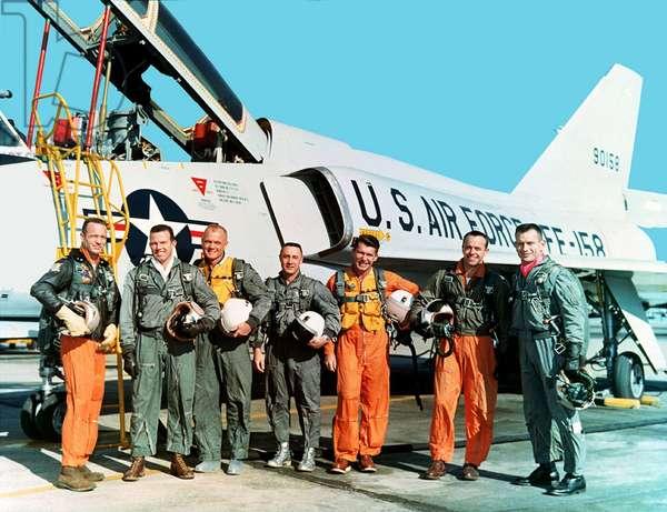 Original seven Project Mercury astronauts standing beside a Convair 106-B aircraft. Left to right, M. Scott Carpenter, L. Gordon Cooper Jr., John H. Glenn Jr., Virgil I. Grissom, Walter M. Schirra Jr., Alan B. Shepard Jr., and Donald K. Slayton. Each made ground breaking space flights between 1961-1963